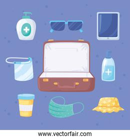 new normal travel suitcase with mask medicine hat glasses and smarthpone