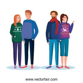 men and women with merry christmas sweaters