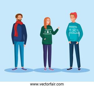 young people with merry christmas sweaters