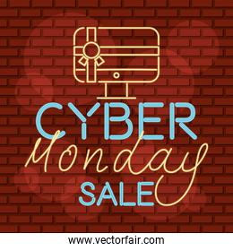 cyber monday neon label with desktop in red wall