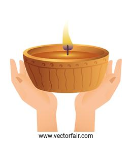 hands lifting wooden diwali candle decorative icon