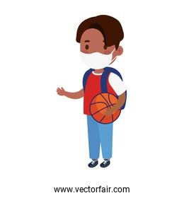 little boy wearing medical mask and basketball balloon