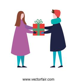 young couple wearing winter clothes with gift