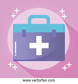 doctor suitcase with a cross on pink background