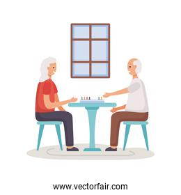 active seniors couple playing ludo characters