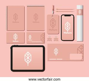 notebooks and bundle of mockup set elements in pink background