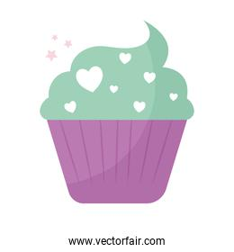 cupcake topped with green and hearts frosting