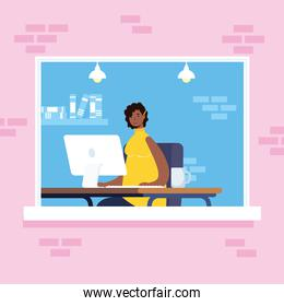 afro ethnic woman using desktop in workplace window scene