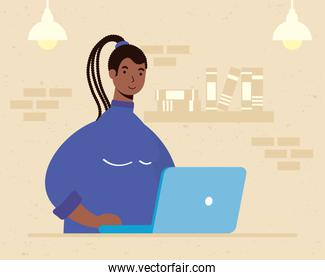 afro ethnic woman using laptop in the house