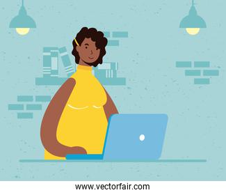 afro ethnic woman using laptop in the house scene
