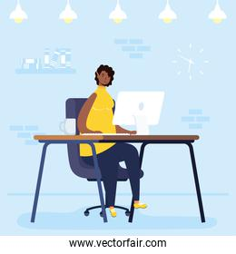 afro ethnic woman using desktop in workplace