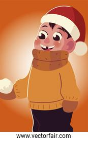 happy little boy in winter clothes and snowball