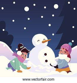 cute little girls with snowman playing falling snow