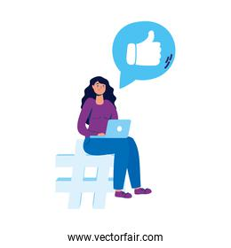 young woman seated in numeral symbol using laptop and social media