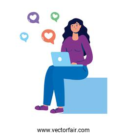 young woman seated using laptop with social media icons