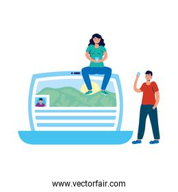 young couple using smartphones seated in laptop