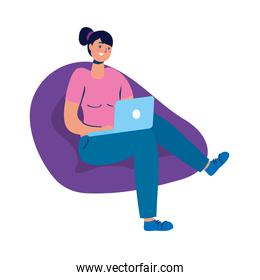 young woman seated in sofa using laptop technology character