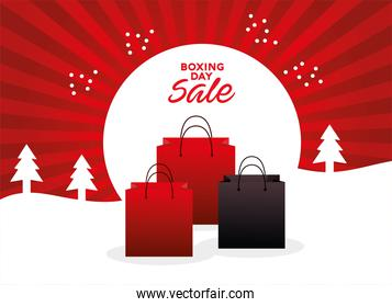 boxing day sale lettering with shopping bags in snowscape