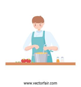 male chef with pot preparing soup with tomatoes