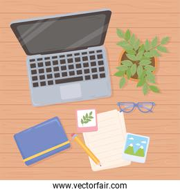 workspace office laptop glasses book paper pencil and plant top view design