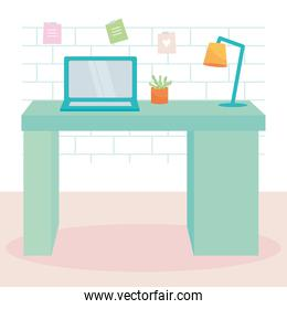 green desk with laptop computer, plant and desk lamp, colorful design