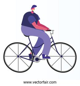man wearing medical mask riding bicycle activity