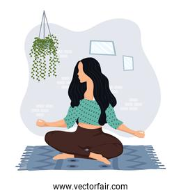 young woman practicing yoga in the house