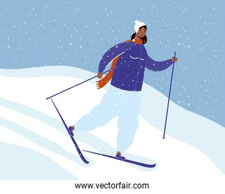 young afro woman wearing winter clothes practicing ski in snowscape