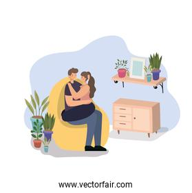 romantic couple sit and hugging on a room with plants