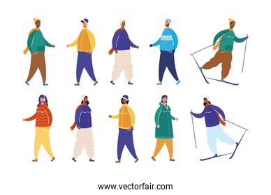 interracial people group wearing winter clothes practicing ski