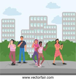 people with smartphone in front of city buildings vector design