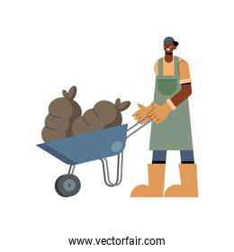 Farmer man with bags on wheelbarrow and overall vector design