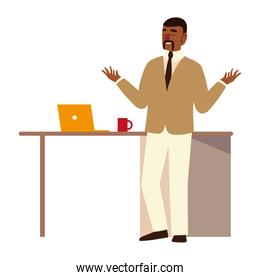afro american business man with laptop and coffee cup on desk