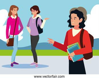student man and girls talking, holds books outdoors