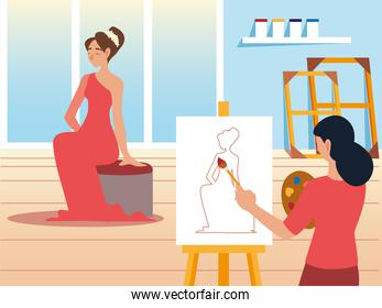 young woman painting with brush on canvas in a studio a model female