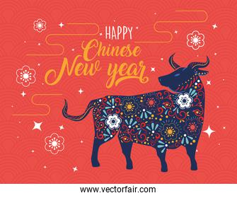 chinese new year card with floral pattern in ox and lettering