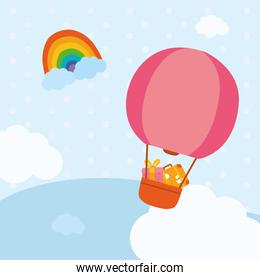 Hot air balloon with gift and bag at sky vector design