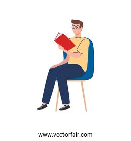 man wearing eyeglasses reading text book seated in chair