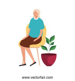 elderly old woman seated in chair and houseplant character