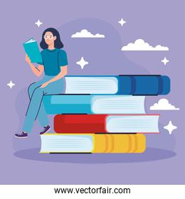 woman wearing eyeglasses reading text book seated in books