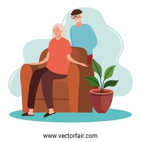 elderly old couple seated in the livingroom