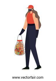 delivery woman with safety mask and one mesh bag full of market products