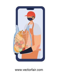 online ordering and delivery man with safety mask and one plastic bag full of market products on a phone