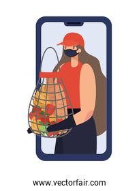 online ordering and delivery woman with safety mask and one mesh bag full of market products on a phone