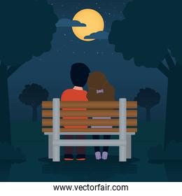 couple in love sitting on a bench over night landscape background