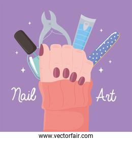 manicure, female hand showing painted nails with file cutter and nail polish