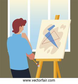 painter man painting with abstract picture on canvas in a studio
