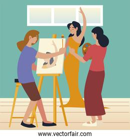 young women painting with brush on canvas in a studio a model female