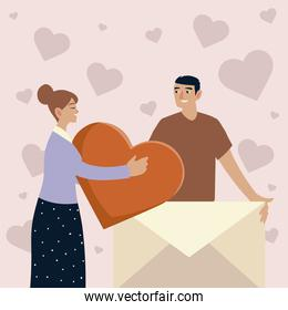 young couple with heart and envelope love romantic message