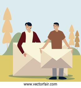 young men with envelope mail message outdoors